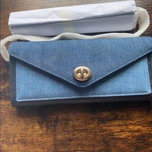 Coach turn lock envelope clutch/ wallet